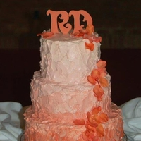 Peach Ombre Wedding Cake WASC cake...10, 8 and 6 inches. Frosted with Italian Buttercream. White chocolate initials. Gumpaste petals.