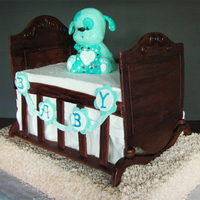 Dog Gone Cute On Cradle Baby crib out of pastillage, RC Dog sculpture, vanilla cake with lemon curd and lemon cream filling. Base cake was decorated in butter...