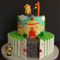 Rolie Polie Olie Vanilla-Black Cherry cake with marrachino swiss meringue filling covered in butter cream. Details are buttercream, fondant and pastillage...