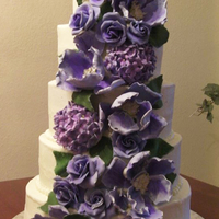 5 Tier White Cake With Pina Colada Filling And Coconut Cream Cheese Frosting Cascading Lilac And Purple Gumpaste Flowers 5 tier white cake with pina colada filling and coconut cream cheese frosting. Cascading lilac and purple gumpaste flowers,