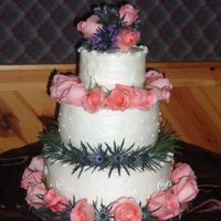 Wedding Cake All of the cake is a yellow cake with BC frosting. The bride chose roses and thistle. She also requested that there monogram be wrtiten on...