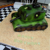 Army Tank My grandson wanted an army tank for his 8th birthday party. Here is what I came up with.Cake is Lemon with raspberry filling. Buttercream...