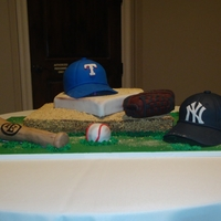 Tx Vs Ny Grooms cake for couple that has a big rivalry. Groom is a total TX fan while the bride is all NY. Glove and bat are RKT all other is cake....