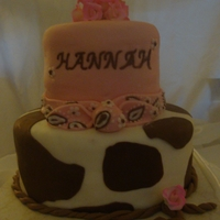 Cowgirl Cake made for a sweet family that just adopted a baby girl. Cake was done to match theme of nursery