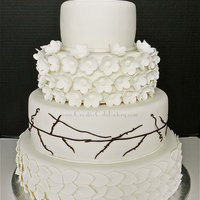 Nature Wedding Cake Ivory wedding cake. Sugar flowers, leaves and branches.