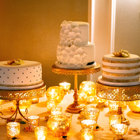 Gold & Ivory Wedding Cakes   Group of cakes instead of one large cake.