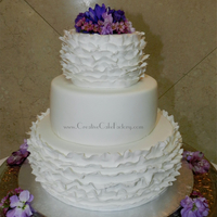 White Ruffle Wedding Cake White Ruffle Wedding Cake. Fresh flowers on top.