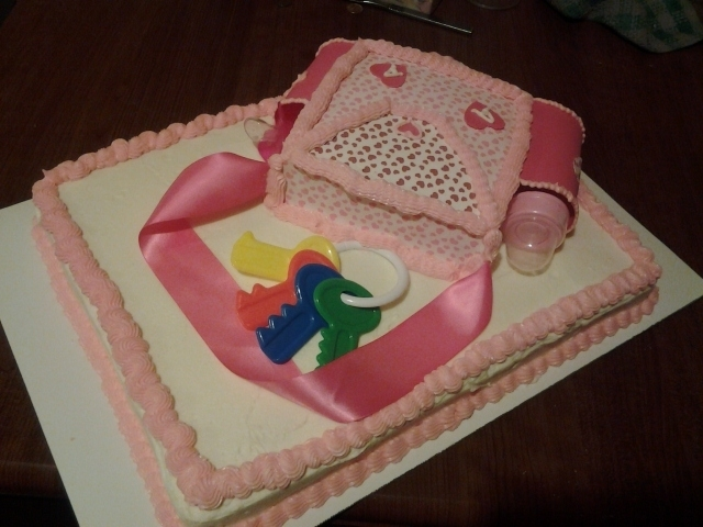 Another Baby Bag Cake I used Wilton frosting sheets for this mini baby bag cake