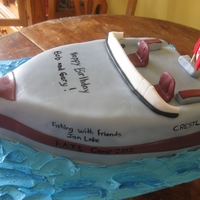 Boat 2 stacked 9 x 13 cakes carved and coverd in mmf.