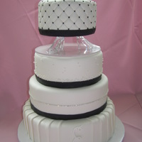 Pleated Wedding Cake this was fondant covered cake with fondant pleating, quilting and a rhinestone belt