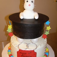 Magic Cake this was for a child who loves magic. the hat is rkt and the cake is buttercream