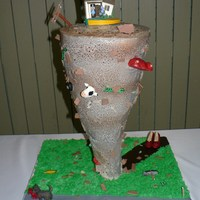 "Tornado Cake this cake was created for a groom that is a storm chaser. it stood 22"" tall and had handmade gumpaste accents that we delivered @7..."