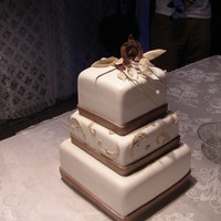 1315191986.jpg this was created for a taupe and brown weddinghas a handmade gumpaste orchid