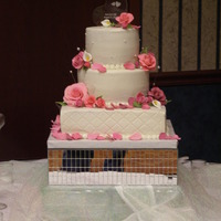 Wedding Cake With Pinks this cake had handmade gumpaste roses in multi shades of pink