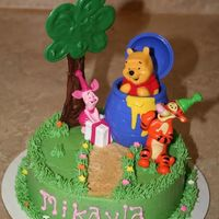 "Winne The Pooh Smash Cake 6"" choc cake with bc. Tree is chocolate. Winnie Pooh from Decopac. Gave me Winnie after I'd decorated that's why the fit is..."