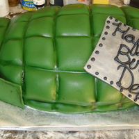 Grenade Chocolate cake w/strawberry b/c covered in fondant.Made this for my nephew's 7th military themed birthday bday. Fondant accents and...
