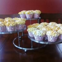 Popcorn Cupcakes Cupcakes covered with marshmallow popcorn, printed wrappers to look like popcorn containers.
