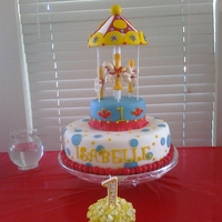 Carousel Cake (Spinning) The base cake is a super moist vanilla w/strawberry filling covered in fondant. The carousel is RKT covered in fondant, with molded...