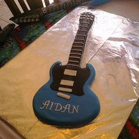 Blue Electric Guitar Fondant covered chocolate cake.