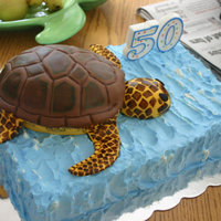 Turtle Cake RKT turtle covered in fondant and hand painted. Ocean cake iced with Pastry Pride.
