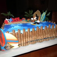 Surfing Mickey Mouse A great cake I made for a client!!! And he loved it so much when he saw it he ran to me and said I LOVE YOU!!! :-)