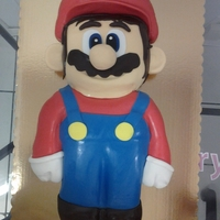 3D Super Mario Carved Cake Mario is all cake with the exception of his hat, nose, and ears..they were all made of rice crispie treats, My second carved cake ever and...