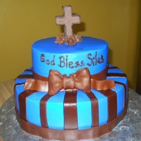 Baby Baptism bc frosting with mm fondant decorations. bow is made of gumpaste.