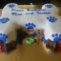 Doggie Bone This cake was done for a friend's birthday for their dog. It's all bc frosting and chocolate decorations.