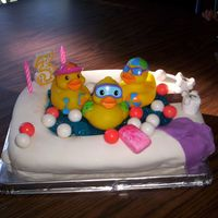 Rubber Duckies In Bathtub  My daughter wanted Duckies & Gum on her cake, this is what I came up with. The water is jello, the soap and washcloth are marshmallow...