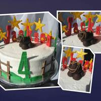 Western Cake Cake was covered in buttercream icing with fondant decorations.