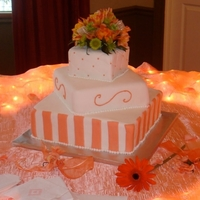 Square Offset Autumn Wedding Cake Square, offset fondant with silk flower topper and quilted top layer.