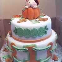 Baby In A Pumpkin For pumpkin themed first birthday party. Topper is rice crispy treats and fondant.