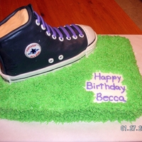 Converse Shoe   Birthday girl wanted a shoe cake to match her own shoes. Shoe is RKT covered with fondant on a WASC cake. Converse logo is hand painted.