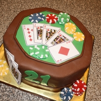 Poker Table Cake   For a young man turning 21 and celebrating at a casino. The brown is chocolate fondant and the rest is MMF.