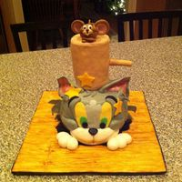 Tom And Jerry Cake Tom and Jerry cake for my sons birthday from cartoon cakes book. Old school! The cake design was from Debbie Browns Cartoon Cakes book. I...