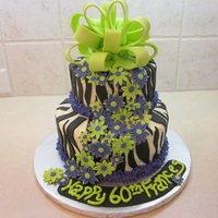 Frances' Birthday 2011 This was a surprise cake for my sister. The colors were lime green and purple, but the picture looks like lime green and blue. Anyway, I...