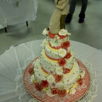 Red And White Round wedding cakes. Different flavor tiers,willow creek figurine on top. For one of my girls.