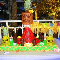 "Luau this is my take on ""CAKEBOSS') Luau Cake. Served 150, sugarpaste flowers, tikis are modeling choc covered rice crispies,..."