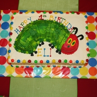 Very Hungry Caterpillar Cake Rainbow cake with chocolate caterpillar. All buttercream frosting.