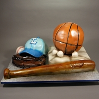 Sports Ball Themed Baby Shower. Decorated in fondant, modeling chocolate, RKT and gumpaste.