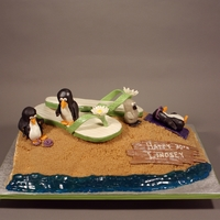 Flip Flop And Penguins 30Th Birthday Cake Decorated in fondant, modeling chocolate, piping gel, RKT, crushed cookies and brown sugar.