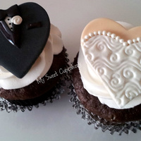 Bride & Groom Chocolate cupcakes with Raspberry filling. French buttercream.