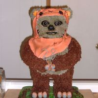 Wicket The Ewok  I used a combination of star tips and grass tips for his fur. His fingers, toes, and cowl are made of fondant. His arms, legs, and ears are...