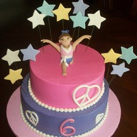 Gymnastics Birthday Buttercreme iced. Fondant decorations. Figure a la Aine2 and her invaluable tutorials