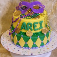 Mardi Gras  Cake is iced in buttercream. Stringed beads and coins are store bought (I was not charging a lot so I did not want to spend time making...