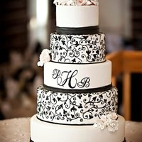 Black And White Monogram   5 tier black and white with scrollwork and gumpaste flowers
