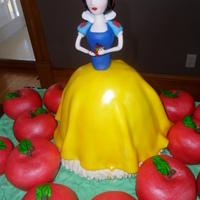 Snow White Snow White Cake. Dress is cake, Snow White is gumpaste. Apples are cupcakes, iced and wrapped in fondant,