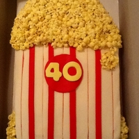 Popcorn Cake Made for someone that loves popcorn. This was a big cake 11 X15. I made the recipe for Rice Krispie Treats...but used popcorn instead.