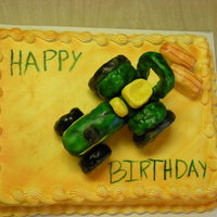 John Deer Tractor  For my grandpa's birthday I made him a John Deer tractor cake, because he is a farmer and loves John Deer's. The tractor is made...