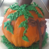 Pumpkin Pumpkin spice covered with Cream Cheese frosting. Stem and tree branch are mmf. Ivy and grass are butter cream.